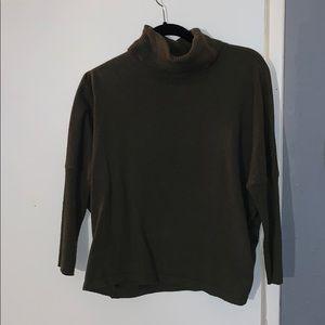 Dark green loose turtle neck sweater